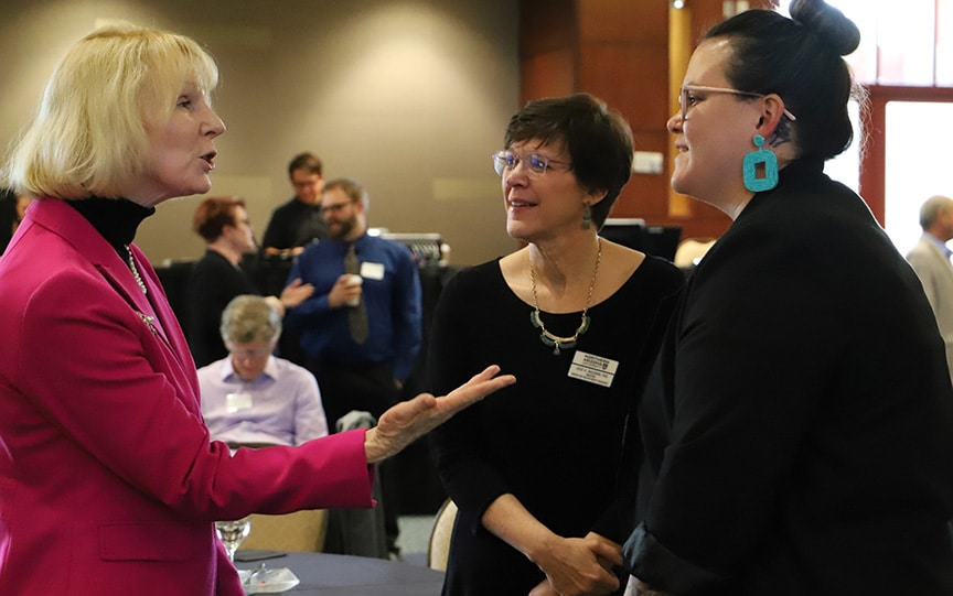 From left, Judge Kathleen Quigley, an NAU alum, talks with Julie Baldwin and Carly Camplain from the Center for Health Equity Research at the juvenile justice workshop on Sept. 26.