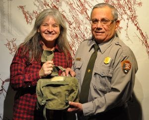 Rachel Cox Tso gives her pack to a ranger