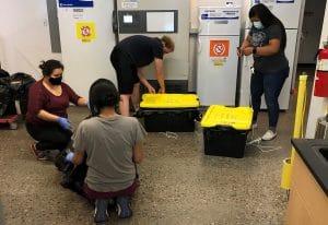 Student researchers prepare hand sanitizer in Jani Ingram's chemistry lab.