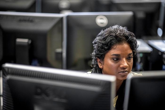 girl sits at computer