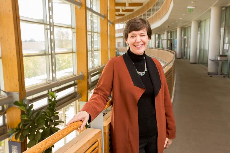 Julie Baldwin stands in building