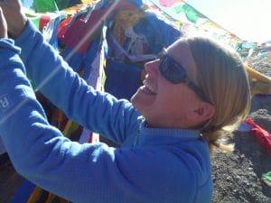 Julie Mueller hangs prayer flags in Nepal