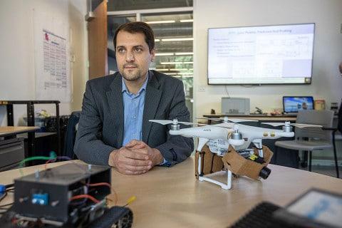 Abolfahl Razi sits with his drones.