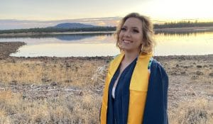 Valeria poses in graduation gown