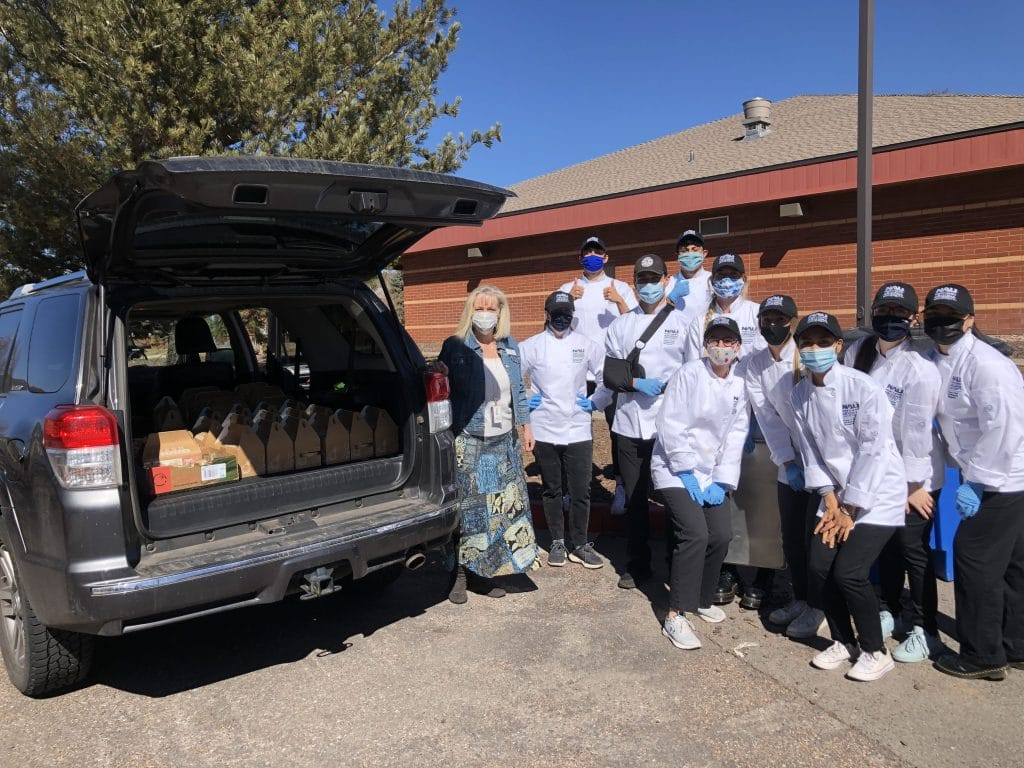 HRM students stand together while meals are picked up