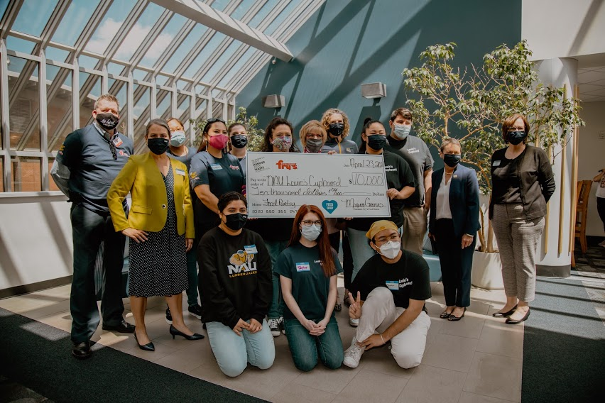 Louie's Cupboard and Fry's representatives pose with check