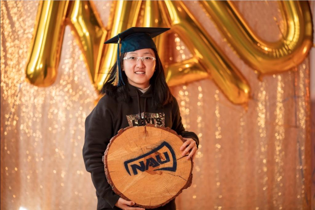 Luyi Liu poses with NAU cookie