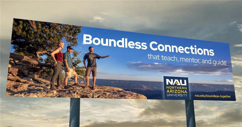 Billboard of three people at the edge of the Grand Canyon that says Boundless Connections that teach, mentor and guide