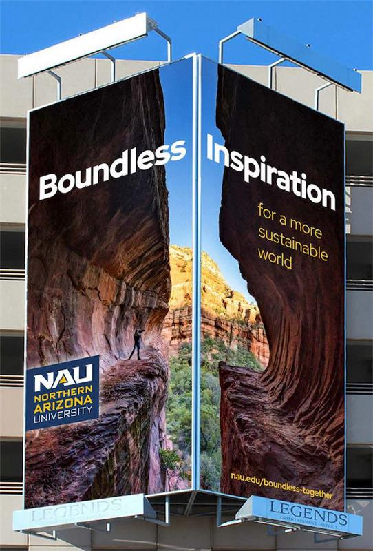 Picture of billboard with a canyon that reads Boundless Inspiration
