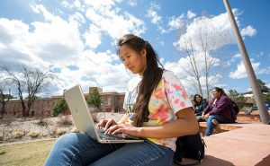 Native American woman works on her computer