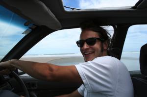 Jack Reid driving a car