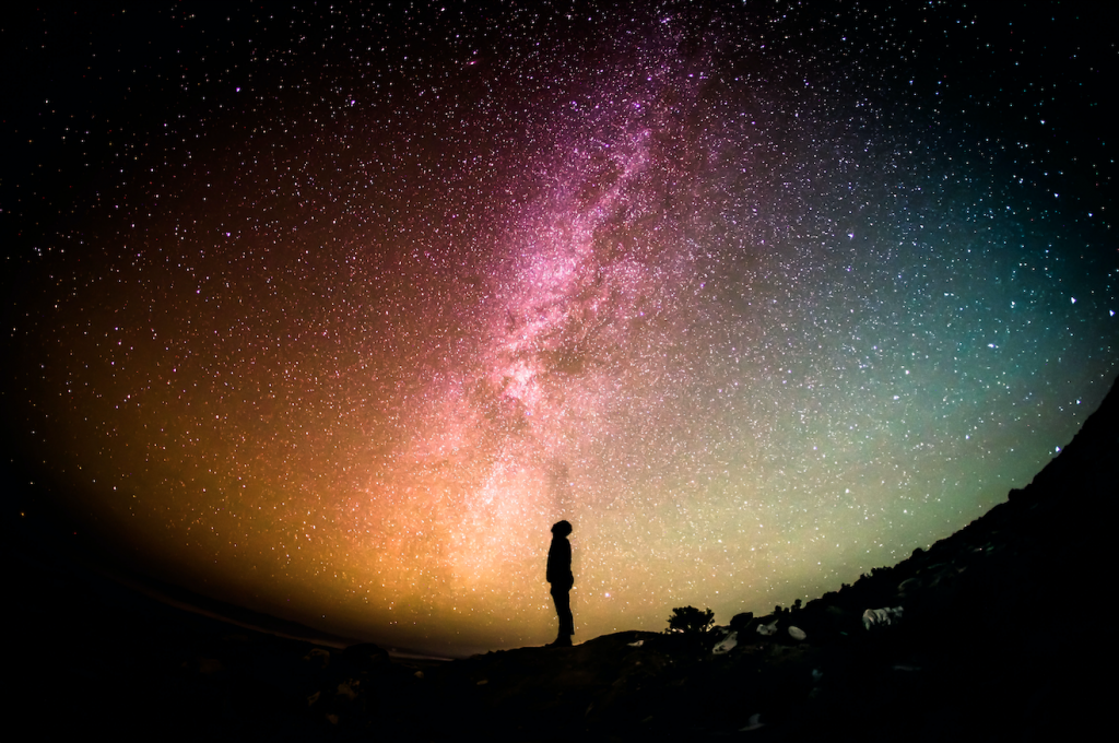 Person looks up at milky way