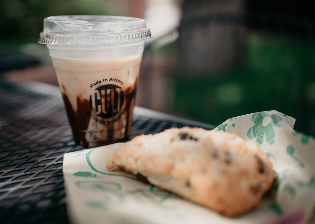 Cup of chocolate coffee drink and a scone