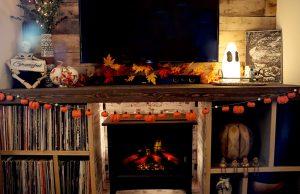 Pumpkin garland hangs on TV stand